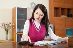 Serious  woman calculating the family budget Royalty Free Stock Photos