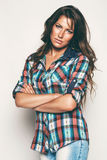 Serious woman in check shirt. In studio Royalty Free Stock Photography
