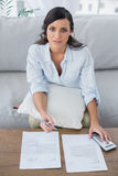 Serious woman checking her bills Royalty Free Stock Photos