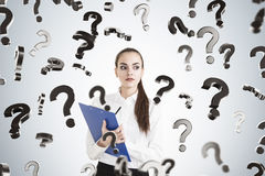 Serious woman with clipboard and questions Royalty Free Stock Images