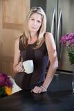 Serious Woman with Coffee Mug Stock Photo
