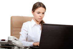 Serious woman at computer Royalty Free Stock Photo