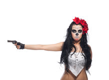 Serious woman in day of the dead mask with gun Stock Image