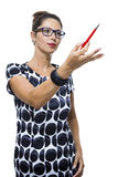 Serious Woman in a Dress Holding Ballpoint Pen Royalty Free Stock Photography