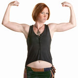 Serious Woman Flexing Muscles Stock Image