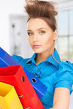 Serious woman with folders. Bright picture of serious woman with folders Royalty Free Stock Photo