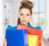 Serious woman with folders Stock Photography
