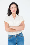 Serious woman frowning. On white background royalty free stock photography