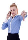 Serious woman gesturing thumbs down Royalty Free Stock Image