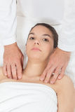 Serious woman getting massage Stock Images