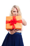 Serious woman with gift box Stock Images