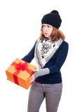 Serious woman with gift Royalty Free Stock Photo