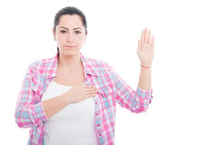 Serious woman giving a gesture of swear Stock Image