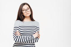 Serious woman in glasses and arms folded Stock Image