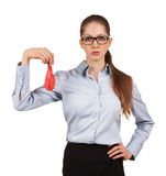 Woman in glasses holding a deflated balloon Stock Photos