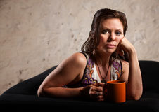 Serious Woman with Hand on Cheek Royalty Free Stock Photos