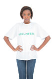 Serious woman with hands on hips wearing volunteer tshirt Royalty Free Stock Photo