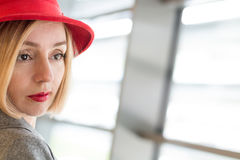 Serious Woman in a Hat. Copy Space Stock Photo