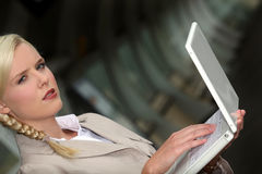 Serious woman on her laptop Royalty Free Stock Photo