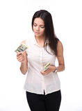 Serious woman holding bills of dollar Royalty Free Stock Image