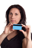 Serious woman holding blue credit card Stock Images
