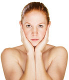 Serious Woman Holding Face Stock Image