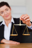 Serious woman holding the justice scale Royalty Free Stock Photo