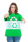 Serious woman holding and pointing at empty recycling bin Royalty Free Stock Photos