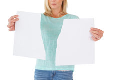 Serious woman holding torn sheet of paper Royalty Free Stock Photos