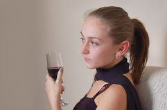 Serious woman holding wine Royalty Free Stock Photography