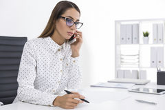 Serious Woman In A Polka Dot Blouse Is On The Phone Stock Images