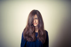 Serious woman with long hair Royalty Free Stock Image