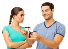 Serious Woman Looking At Man Cutting Credit Card Stock Photos