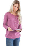 Serious woman looking at tablet pc Royalty Free Stock Images