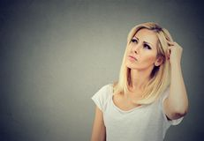 Serious woman looking up in contemplation royalty free stock images
