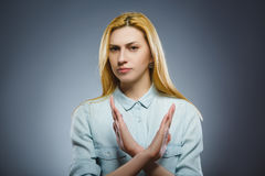 Serious woman making X sign with her arms to stop doing something Stock Photo