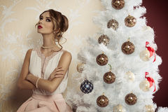 Serious woman near christmas tree Royalty Free Stock Images