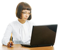 Serious woman in office. Serious woman in the office with the computer Royalty Free Stock Image
