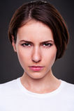 Serious woman over dark background Stock Image