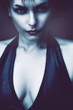 Serious woman with pale skin. In dark Stock Photos