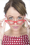 Serious Woman Peering Over Glasses Stock Photography