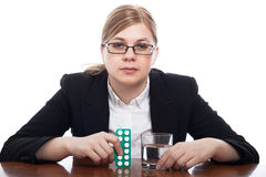 Serious woman with pills Stock Image