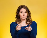 Serious woman pointing finger at someone, blaming Stock Photo