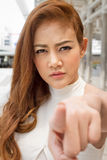 Serious woman pointing finger at you Royalty Free Stock Images