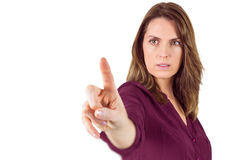 Serious woman pointing her finger at camera Royalty Free Stock Image