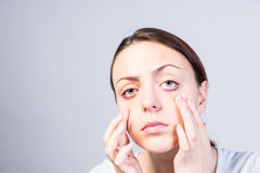Free Serious Woman Pulling Down Her Lower Eyelids Royalty Free Stock Photo - 52567675