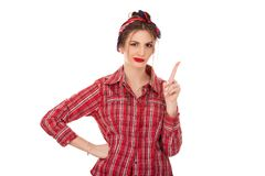Serious woman raising finger up gesturing a no sign royalty free stock images