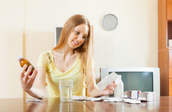 Serious  woman reading manual of medications Stock Photos