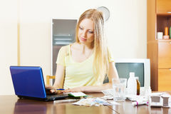 Serious woman reading about medicines Stock Photo