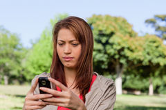 Serious woman reading a text message Stock Photos
